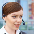 Businesswoman with headset. — Stock Photo