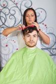 Hair salon. Hairdresser does haircut for man. — Foto Stock