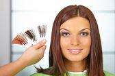 Hair salon. Woman choses color of dye. — Stock Photo