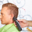 Hair salon. Hairdresser does haircut for man. — Stock Photo