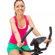Young womuses stationary bicycle trainer. — Stock Photo #39154311