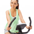 Young womuses stationary bicycle trainer. — Stock Photo #39154319