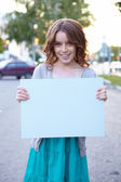 Young woman with blank banner. — Stock Photo