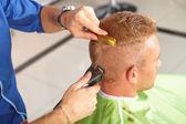 Hair salon. Hairdresser does haircut for man. — Stock Photo