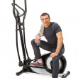Young womuses elliptical cross trainer. — Stock Photo #40069933
