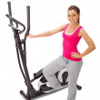 Young woman uses elliptical cross trainer. — Stock Photo #40069943