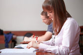 Back to school. Students in classroom. — Stock Photo