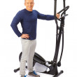 Young man uses elliptical cross trainer. — Stock Photo #41476557