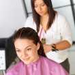 Stock Photo: Hair salon. Womhaircut. Cutting.