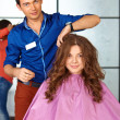 Stock Photo: Hair salon. Womhaircut. Combing.