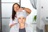 Young woman with towel on head in hair salon. — Stock Photo