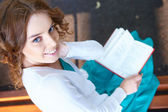 Young woman reads book. — Stock Photo