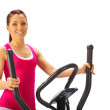 Young woman uses elliptical cross trainer. — Stock Photo #42888307