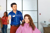 Hair salon. Woman haircut. Spraying. — Stock Photo