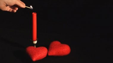Burning candle with two hearts — Stock Video