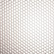 Honeycomb grid against white background — Stock Photo