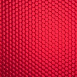 Honeycomb grid against red background — Stock Photo