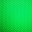 Honeycomb grid against green background — Stock Photo