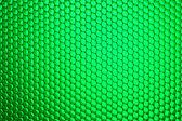 Griglia a nido d'ape su sfondo verde — Foto Stock