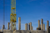 Bottom of tower crane on construction site — Stock Photo