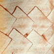 Stock Photo: Copper rhomb on white wall