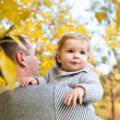 Cute little boy with his father in the autumn park — Stock Photo