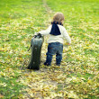 Cute little boy with a big suitcase — Stock Photo