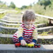 Stock Photo: Little cute boy on railroad