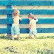 Stock Photo: Two little cute boy standing back