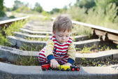 A little cute boy on the railroad — Stock Photo