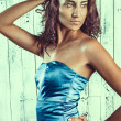 Beautiful woman in a blue dress — Stock Photo