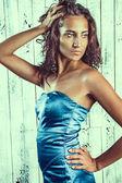 Beautiful woman in a blue dress — Stock Photo