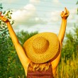 Young woman arms raised enjoying the fresh air in green forest — Stock Photo #32878207