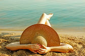 Girl lying on the beach — Stock Photo