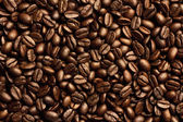 Roasted brown coffee beans, can be used as a background and texture — Stock Photo