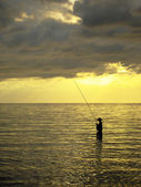 Silhouette of a fishing man in a sunset - sunrise, Bali, Indonesia — Stock Photo