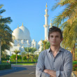 A young man in a park near the mosque — ストック写真