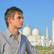 Portrait of a young man in front of mosque — Stock Photo