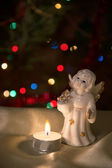 Angel figurine and candle. — Foto de Stock