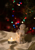 Angel figurine and candle — Foto Stock
