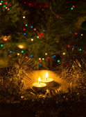 Candles on the background lights on the Christmas tree, bokeh — Stock fotografie
