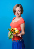 Young woman with a bouquet of tulips — Stock Photo