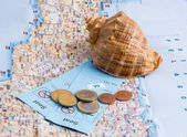 Shell, tickets and coins on the map. — Stockfoto