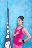 Girl in bright clothes on a background scenery Eiffel Tower, ret — Stock Photo