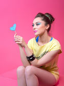 Girl in bright clothes on a pink background, retro style. — Stock Photo