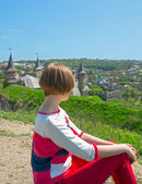 Girl resting, looking at the castle — Stock Photo