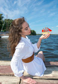 Girl holds a small ship with red sails.  Modern Assol. — Stock Photo