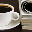 Cup of coffee and opened magazine — Stock Photo