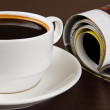 Stock Photo: Cup of coffee and opened magazine