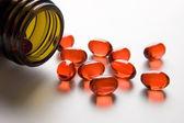 Red vitamin pills — Stock Photo